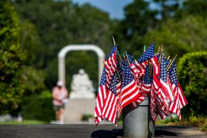 Additional United States Flags await those arriving for Mass at Calvary Catholic Cemetery at Clearwater, Fla. on this warm and breezy Memorial Day, May 27, 2019.