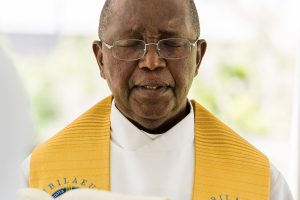 Father Hugh Chikawa in prayer at Mass on Memorial Day.