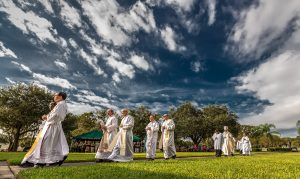Bishop Parkes and priests process to the altar for Mass on All Souls' Day at Calvary Catholic Cemetery.
