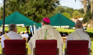 Bishop Parkes delivers a homily to those attending Mass on All Souls' Day at Calvary Catholic Cemetery.