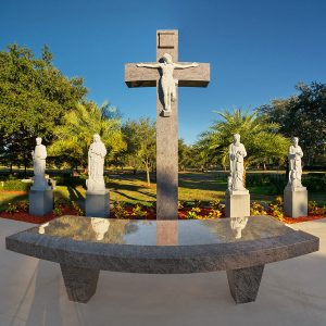 Statues of the four Evangelist, St. Luke, St. John, St. Mark and St. Matthew, flank the image of the Crudifixion of Christ behind the outdoor altar at Calvary Catholic Cemetery.